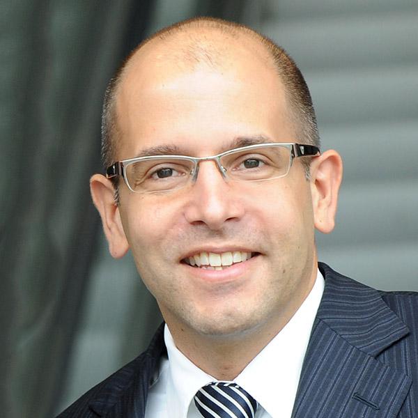 Dr. Christian Tidona